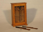 84. Small Gun Cabinet with Guns